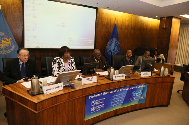 PAHO's Assistant Director Dr. Becerra Posada, Director Dr. Etienne, and Chairperson Hon Dr. Fenton Ferguson of Jamaica